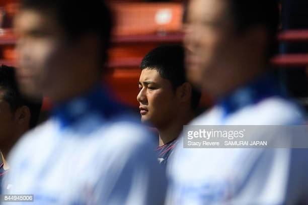 Kotaro Kiyomiya of Japan stands for the Japanese National Anthem prior to a game against Korea during the WBSC U18 Baseball World Cup Super Round...