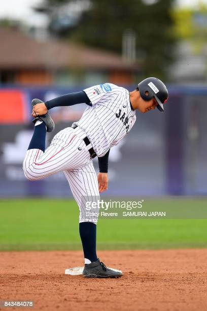 Kotaro Kiyomiya of Japan stretches on second base during a game against South Africa during the WBSC U18 Baseball World Cup Group B game between...