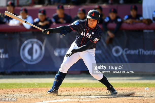 Kotaro Kiyomiya of Japan strikes out during the eighth inning of a game against Korea during the WBSC U18 Baseball World Cup Super Round game between...