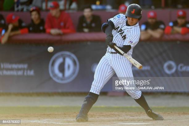 Kotaro Kiyomiya of Japan swings at a pitch during the third inning of a game against Canada during the WBSC U18 Baseball World Cup Super Round game...