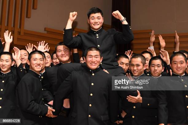 Kotaro Kiyomiya of Waseda Jitsugyo High School is lifted by his team mates after picked up by Hokkaido Nippon Ham Fighters after the 2017...