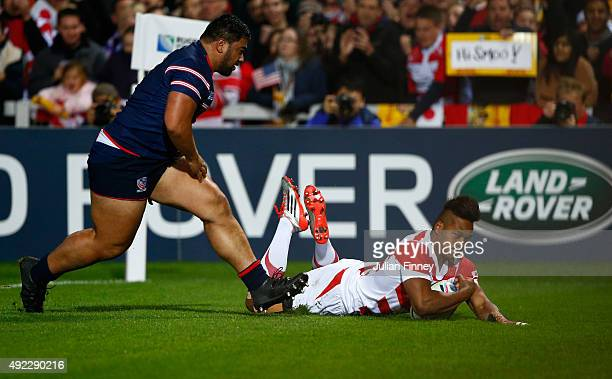 Kotaro Matsushima of Japan goes over to score the opening try during the 2015 Rugby World Cup Pool B match between USA and Japan at Kingsholm Stadium...