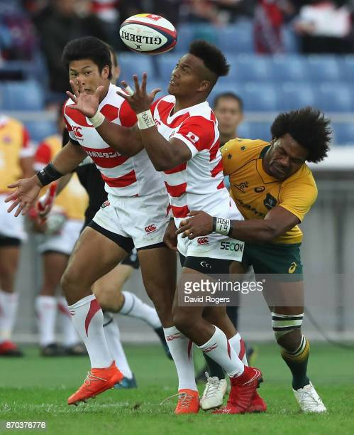 Kotaro Matsushima of Japan is tackled by Henry Speight during the rugby union international match between Japan and Australia Wallabies at Nissan...