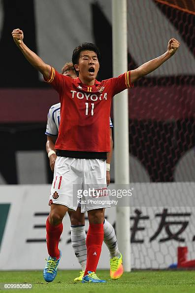 Kotaro Omori of Gamba Osaka who scores the opener celebrated with the cradle dance by the team matesduring the J League match between Nagoya Grampus...