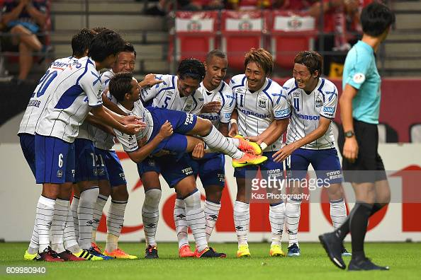 Kotaro Omori of Gamba Osaka who scores the opener celebrated with the cradle dance by the team mates during the J League match between Nagoya Grampus...