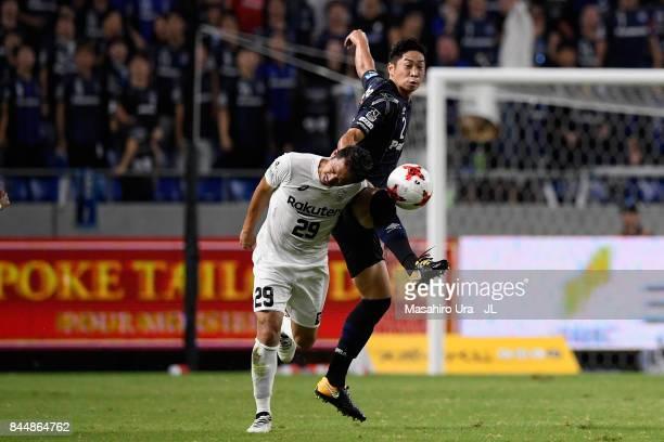 Kotaro Omori of Vissel Kobe and Genta Miura of Gamba Osaka compete for the ball during the JLeague J1 match between Gamba Osaka and Vissel Kobe at...