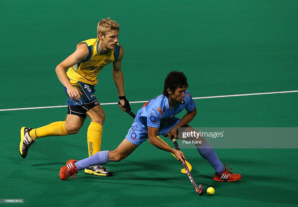 Kothajit Singh Khadangbam of India passes the ball in the mens Australia Kookaburras v India game during day two of the 2012 International Super Series at Perth Hockey Stadium on November 23, 2012 in Perth, Australia.