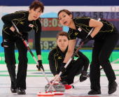 Kotomi Ishizaki Mari Motohashi and Anna Ohmiya of Japan look on during the women's curling round robin game between Japan and Germany on day 10 of...