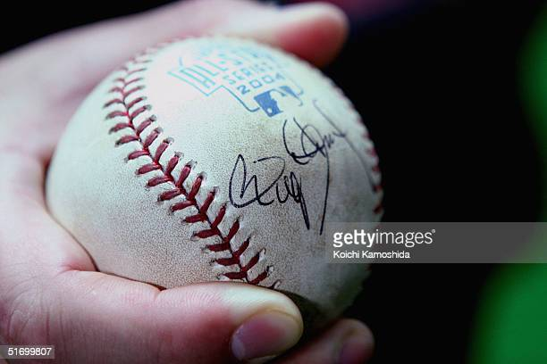 Kotomituki sumo wrestlers holds the autographed ball of Pitcher Roger Clemens of the Houston Astros during the 4nd game of the exhibition series...