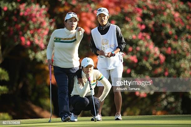 Kotone Hori lines up her birdie putt on the 18th green with her team mate Yumiko Yoshida of Japan during the second round of the THE QUEENS Presented...