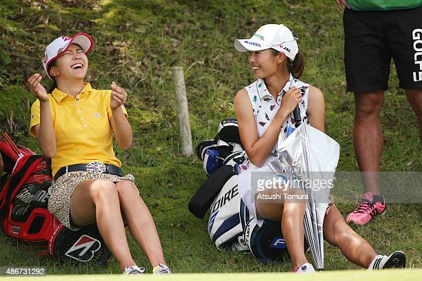 Kotone Hori of Japan and Ayaka Matsumori of Japan smile during the second round of the Golf 5 Ladies Tournament 2015 at the Mizunami Country Club on...