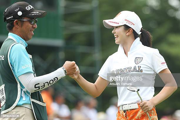Kotone Hori of Japan celebrates after making her birdie putt on the 18th green during the second round of the NEC Karuizawa 72 Golf Tournament 2016...
