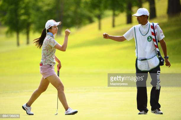 Kotone Hori of Japan celebrates after making her birdie putt on the 17th hole during the final round of the Suntory Ladies Open at the Rokko Kokusai...