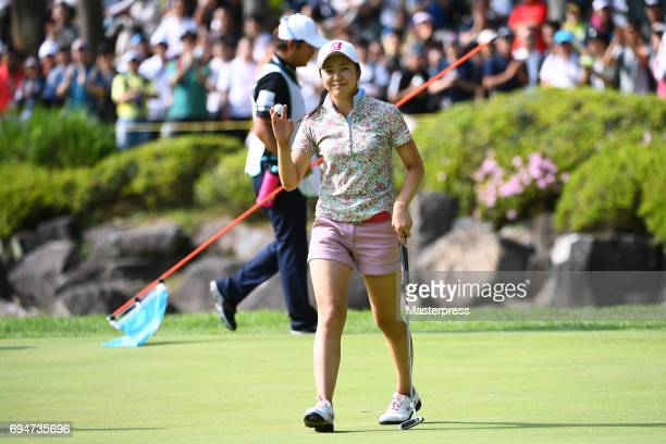 Kotone Hori of Japan celebrates after making her par putt on the 18th hole during the final round of the Suntory Ladies Open at the Rokko Kokusai...