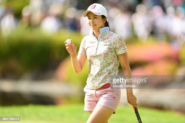 Kotone Hori of Japan celebrates after making her putt on the 18th hole during the final day of the Suntory Ladies Open at the Rokko Kokusai Golf Club...
