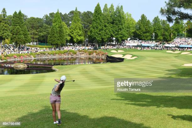 Kotone Hori of Japan hits her second shot on the 18th hole during the final day of the Suntory Ladies Open at the Rokko Kokusai Golf Club on June 11...
