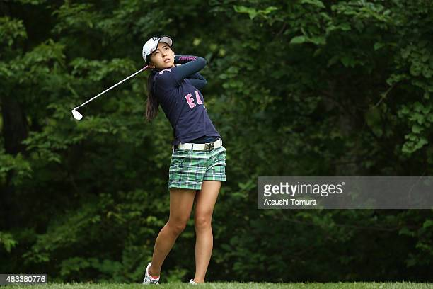Kotone Hori of Japan hits her tee shot on the 7th hole during the second round of the meiji Cup 2015 at the Sapporo Kokusai Country Club on August 8...