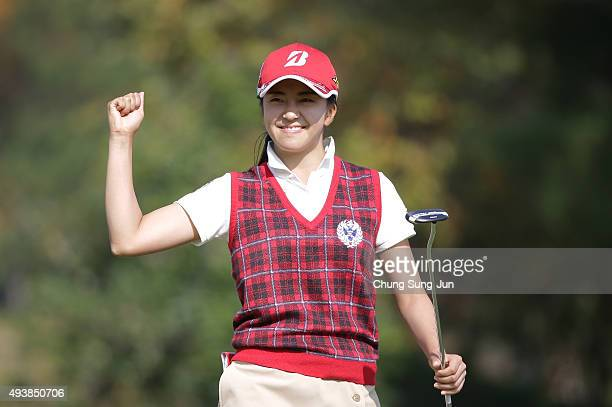 Kotone Hori of Japan reacts after a putt on the 18th green during the second round of the Nobuta Group Masters GC Ladies at the Masters Gold Club on...