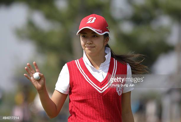 Kotone Hori of Japan reacts after a putt on the 4th green during the third round of the Nobuta Group Masters GC Ladies at the Masters Gold Club on...