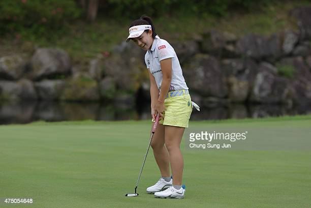 Kotono Kozuma of Japan reacts after a putt during the first round of the Resorttrust Ladies at the Maple Point Golf Club on May 29 2015 in Yamanashi...
