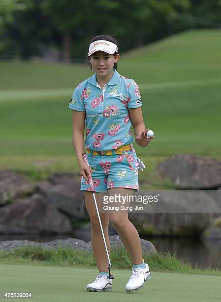 Kotono Kozuma of Japan reacts after a putt during the second round of the Resorttrust Ladies at the Maple Point Golf Club on May 30 2015 in Yamanashi...