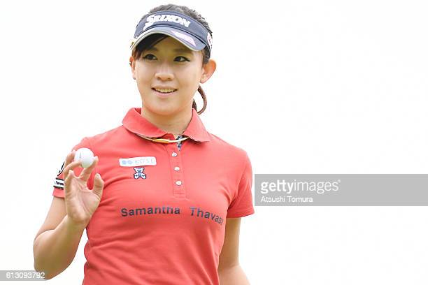Kotono Kozuma of Japan smiles after making her birdie putt on the 1st green during the first round of the Stanley Ladies Golf Tournament at the Tomei...