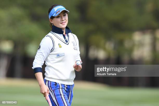 Kotono Kozuma of Japan smiles after making her birdie putt on the th green during the final round of the AXA Ladies Golf Tournament at the UMK...