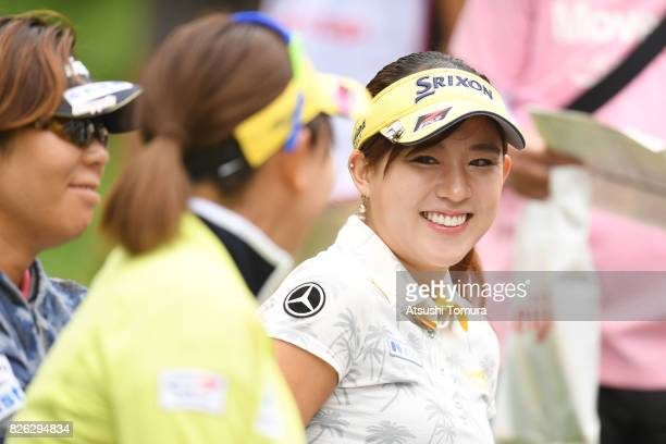 Kotono Kozuma of Japan smiles during the first round of the meiji Cup 2017 at the Sapporo Kokusai Country Club Shimamatsu Course on August 4 2017 in...