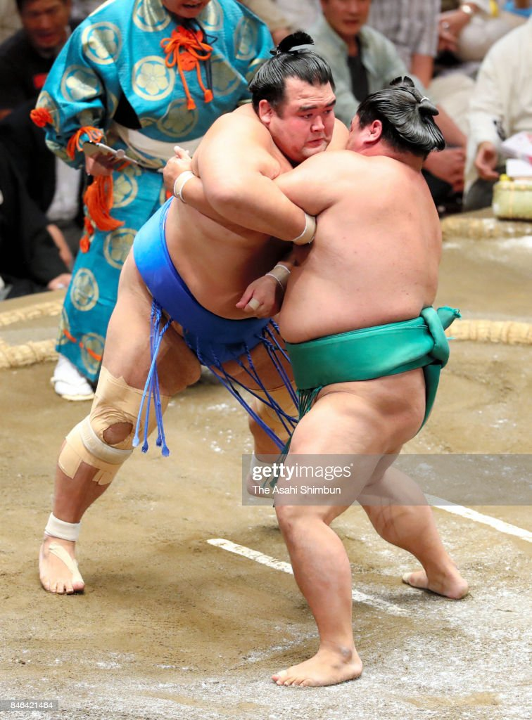 Kotoshogiku (L) and sekiwake Yoshikaze (R) compete in their bout during day four of the Grand Sumo Autumn Tournament at Ryogoku Kokugikan on September 13, 2017 in Tokyo, Japan.