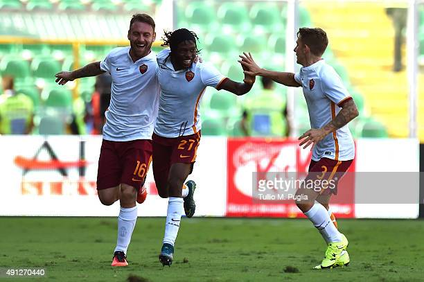 Kouassi Gervinho of Roma celebrates with Daniele De Rossi and Lucas Digne after scoring his team's third goal during the Serie A match between US...