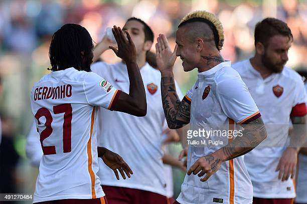 Kouassi Gervinho of Roma celebrates with Radja Nainggolan after scoring his team's third goal during the Serie A match between US Citta di Palermo...