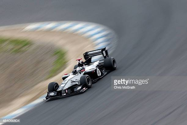 Koudai Tsukakoshi of Japan drives the HP Real Racing SF14 during the Super Formula Round 4 Final Race at Twin Ring Motegi on August 24 2014 in Motegi...