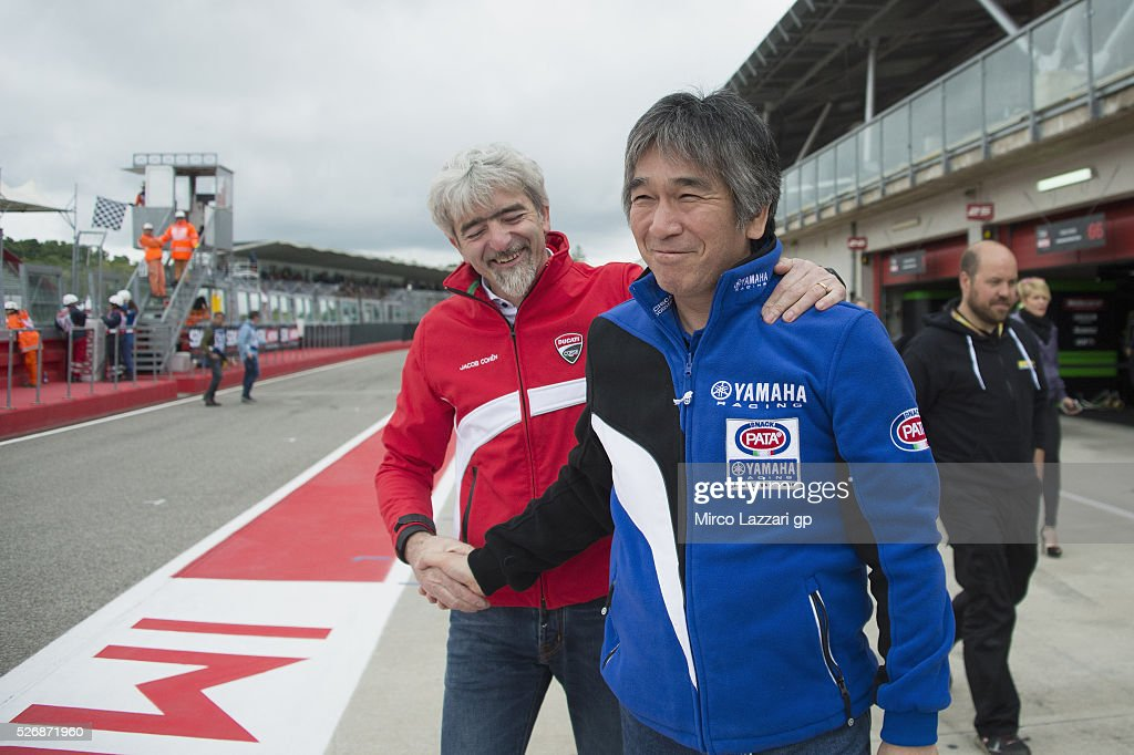Kouichi Tsuji of Japan and Yamaha Factory Team congratulates with Gigi Dall'Igna of Italy (L) at the end of the Superbike race 2 during the World Superbikes - Race at Enzo & Dino Ferrari Circuit on May 10, 2015 in Imola, Italy.