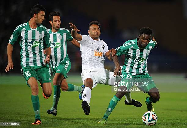 Kouko Guehi of Raja Casablanca fouls Fernandinho of Atletico Mineiro during the FIFA Club World Cup Semi Final match between Raja Casablanca and...