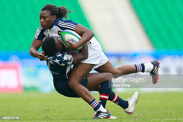 Koumiba Mayans of France is tackled by Victoria Folayan of United States during the day one of IRB Women's Sevens World Series match between France...