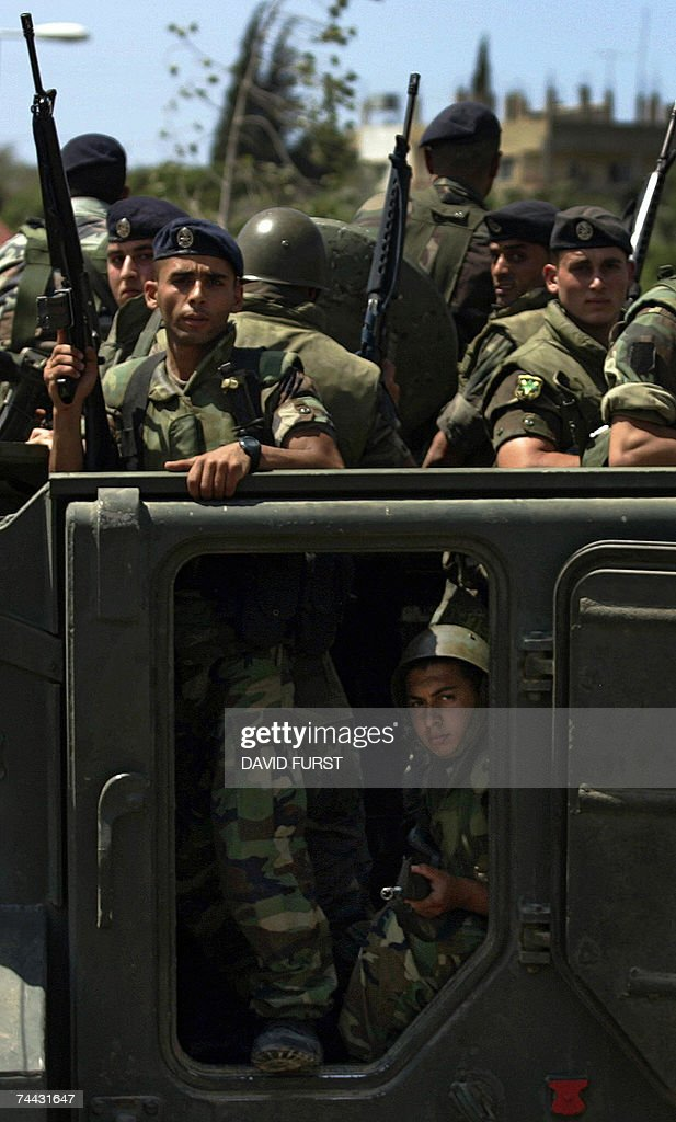 Lebanese soldiers stand in an armoured personnel carrier (APC) as they secure the area around the Maronite church's Notre Dame University, after two sticks of dynamite exploded in a bathroom without causing any injuries, in the northern Lebanese town of Koura, 07 June 2007. Islamist militants locked in a standoff with the Lebanese army threatened today to widen attacks as tanks and helicopter gunships pounded their strongholds inside the impoverished refugee camp of Nahr al-Bared.