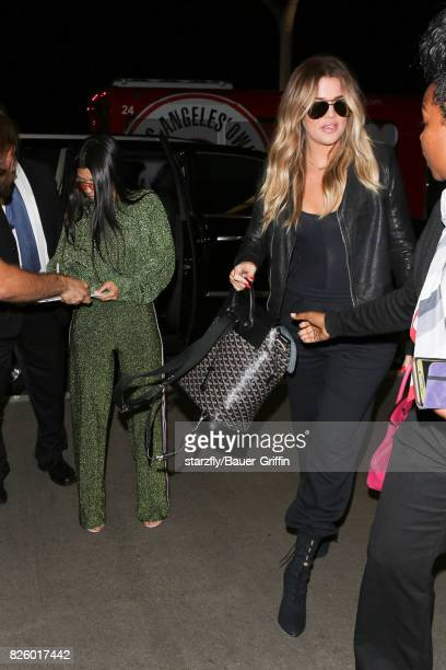 Kourtney and Khloe Kardashian are seen at LAX on August 02 2017 in Los Angeles California
