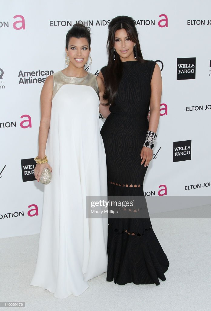 Kourtney and Kim Kardashian arrive at the 20th Annual Elton John AIDS Foundation Academy Awards Viewing Party at Pacific Design Center on February 26, 2012 in West Hollywood, California.
