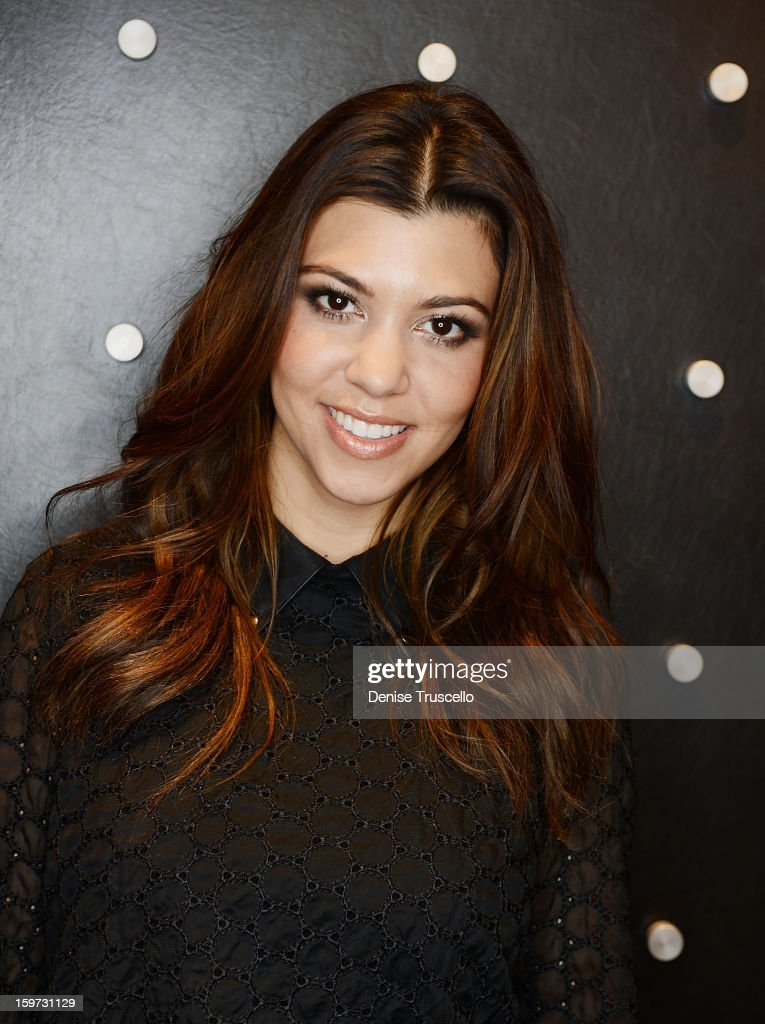 Kourtney Kardashian and Cynthia Bussey during an appearance at Kardashian Khaos at The Mirage Hotel and Casino on January 19, 2013 in Las Vegas, Nevada.
