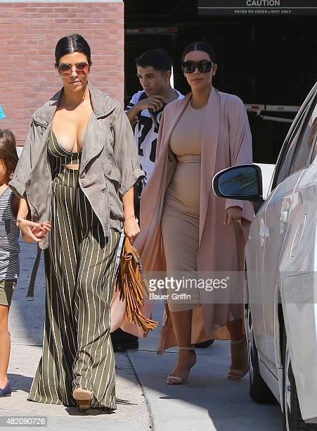 Kourtney Kardashian and Kim Kardashian are seen on July 26 2015 in Los Angeles California
