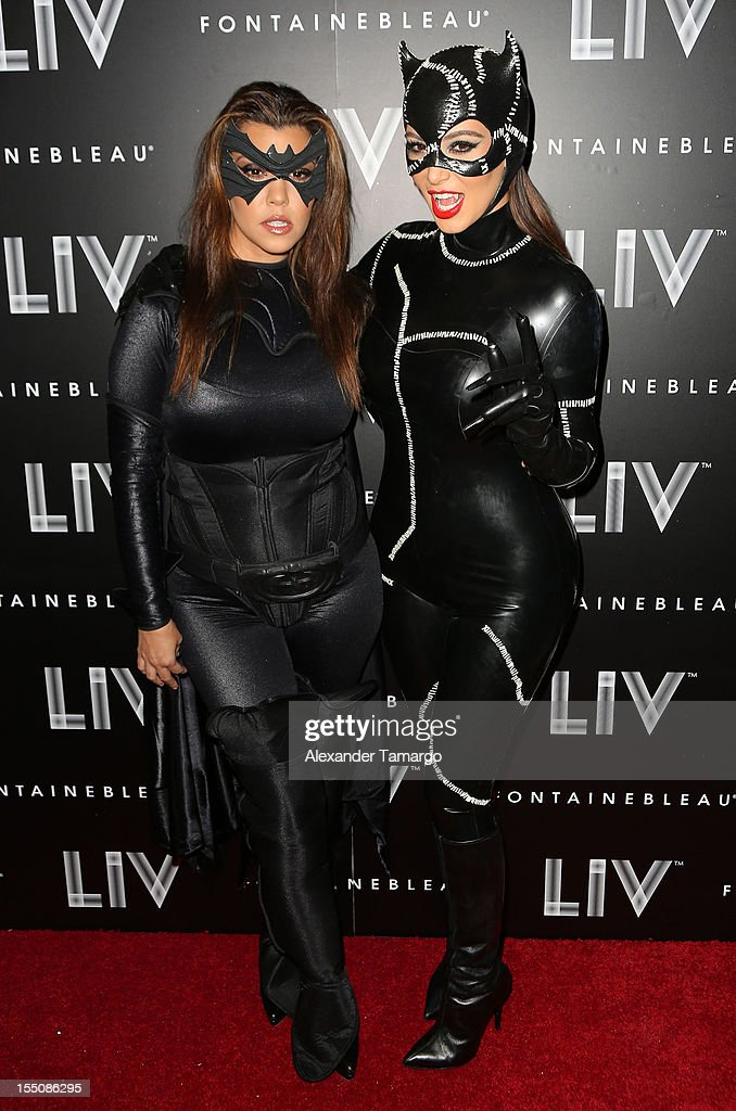 Kourtney Kardashian and Kim Kardashian arrive at Kim Kardashian's Halloween party at LIV nightclub at Fontainebleau Miami on October 31, 2012 in Miami Beach, Florida.