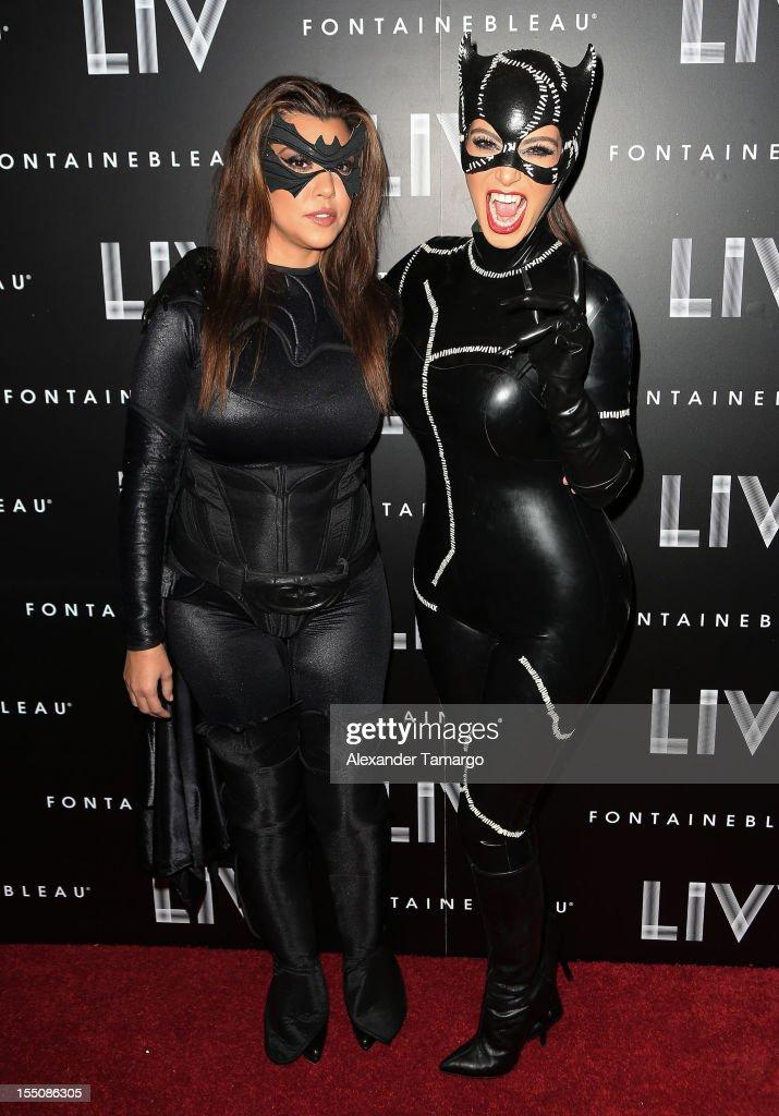 Kourtney Kardashian and Kim Kardashian arrive at Kim Kardashian's Halloween party at LIV nightclub at Fontainebleau Miami on October 31, 2012 in Miami Beach, Florida.