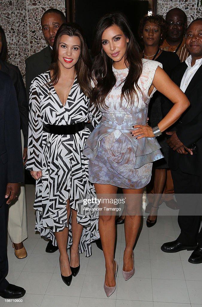 Kourtney Kardashian and Kim Kardashian make an appearance at North Miami City Hall to receive keys to the City of North Miami on November 19, 2012 in North Miami, Florida.