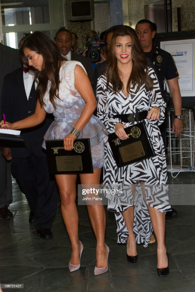 <a gi-track='captionPersonalityLinkClicked' href=/galleries/search?phrase=Kourtney+Kardashian&family=editorial&specificpeople=3955024 ng-click='$event.stopPropagation()'>Kourtney Kardashian</a> and <a gi-track='captionPersonalityLinkClicked' href=/galleries/search?phrase=Kim+Kardashian&family=editorial&specificpeople=753387 ng-click='$event.stopPropagation()'>Kim Kardashian</a> make an appearance at North Miami City Hall to receive key to the City Of North Miami on November 19, 2012 in North Miami, Florida.