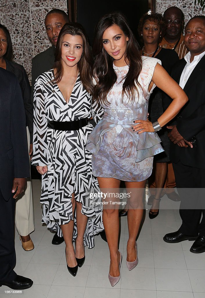 <a gi-track='captionPersonalityLinkClicked' href=/galleries/search?phrase=Kourtney+Kardashian&family=editorial&specificpeople=3955024 ng-click='$event.stopPropagation()'>Kourtney Kardashian</a> and <a gi-track='captionPersonalityLinkClicked' href=/galleries/search?phrase=Kim+Kardashian&family=editorial&specificpeople=753387 ng-click='$event.stopPropagation()'>Kim Kardashian</a> make an appearance at North Miami City Hall to receive keys to the City of North Miami on November 19, 2012 in North Miami, Florida.