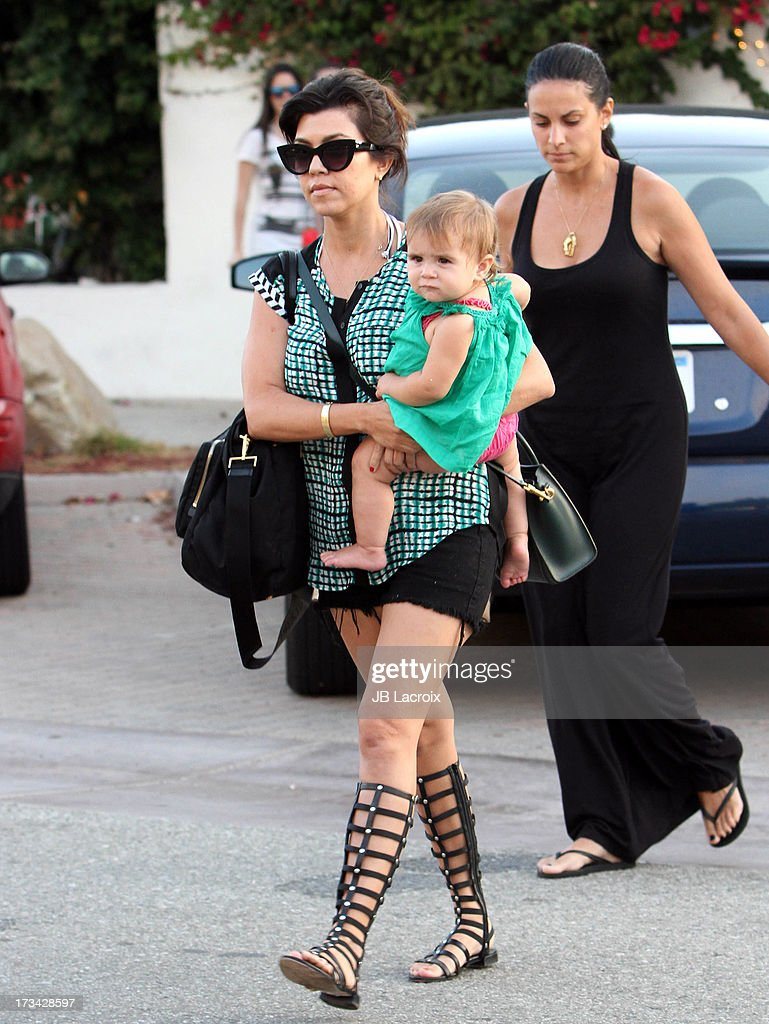 <a gi-track='captionPersonalityLinkClicked' href=/galleries/search?phrase=Kourtney+Kardashian&family=editorial&specificpeople=3955024 ng-click='$event.stopPropagation()'>Kourtney Kardashian</a> and Mason are seen in Malibu on July 13, 2013 in Los Angeles, California.