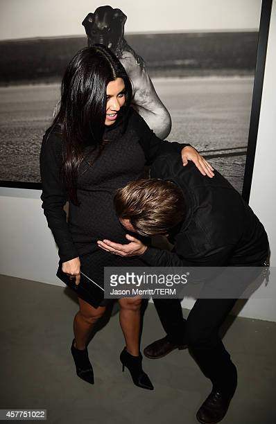 Kourtney Kardashian and photographer Brian Bowen Smith attend the Brian Bowen Smith WILDLIFE show hosted by Casamigos Tequila at De Re Gallery on...