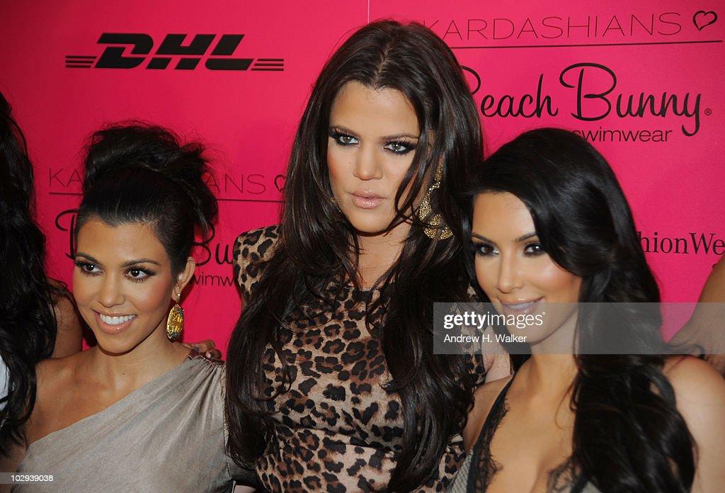 Kourtney Kardashian Khloe Kardashian and Kim Kardashian pose backstage at the Beach Bunny Swimwear 2011 fashion show during MercedesBenz Fashion Week...