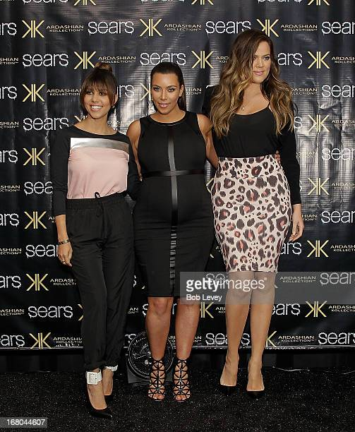 Kourtney Kardashian Kim Kardashian and Khloe Kardashian Odom greet fans during a Sears InStore Appearance For Kardashian Kollection at Willowbrook...