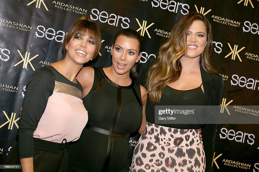 <a gi-track='captionPersonalityLinkClicked' href=/galleries/search?phrase=Kourtney+Kardashian&family=editorial&specificpeople=3955024 ng-click='$event.stopPropagation()'>Kourtney Kardashian</a>, <a gi-track='captionPersonalityLinkClicked' href=/galleries/search?phrase=Kim+Kardashian&family=editorial&specificpeople=753387 ng-click='$event.stopPropagation()'>Kim Kardashian</a> and <a gi-track='captionPersonalityLinkClicked' href=/galleries/search?phrase=Khloe+Kardashian&family=editorial&specificpeople=3955023 ng-click='$event.stopPropagation()'>Khloe Kardashian</a> Odom pose on the red carpet at Sears to promote the 'Spring 2013 Kardashian Kollection' on May 4, 2013 in Houston, Texas.